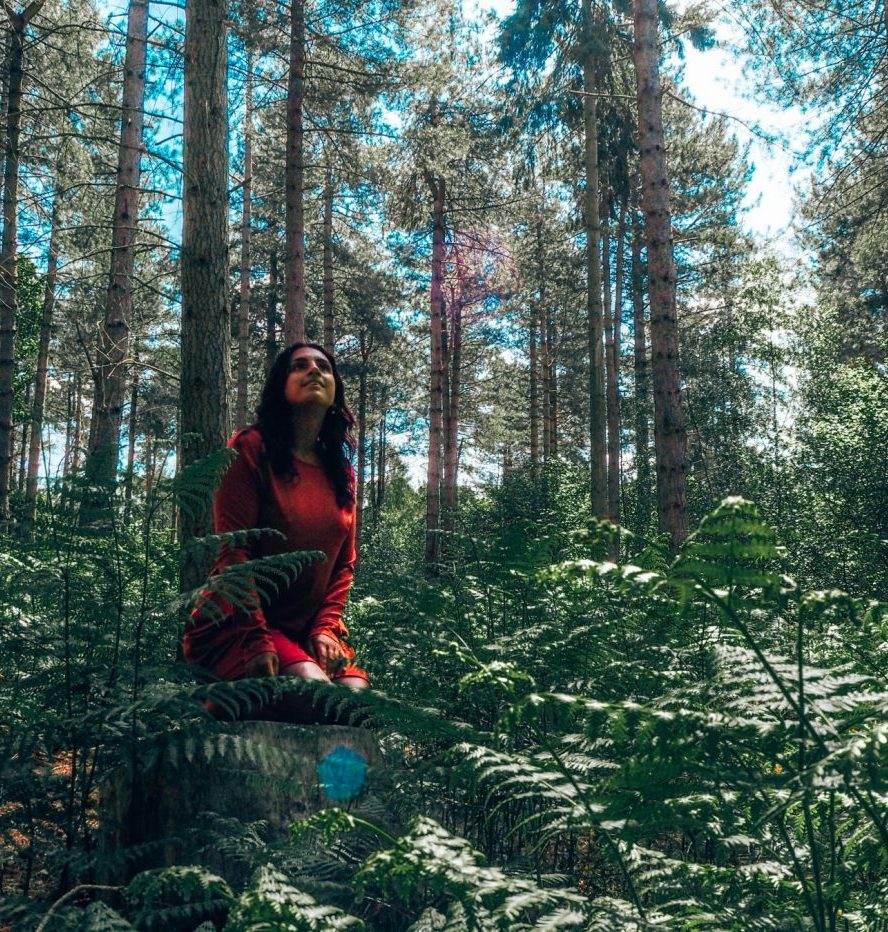 Finding inner peace – girl in red dress in forest