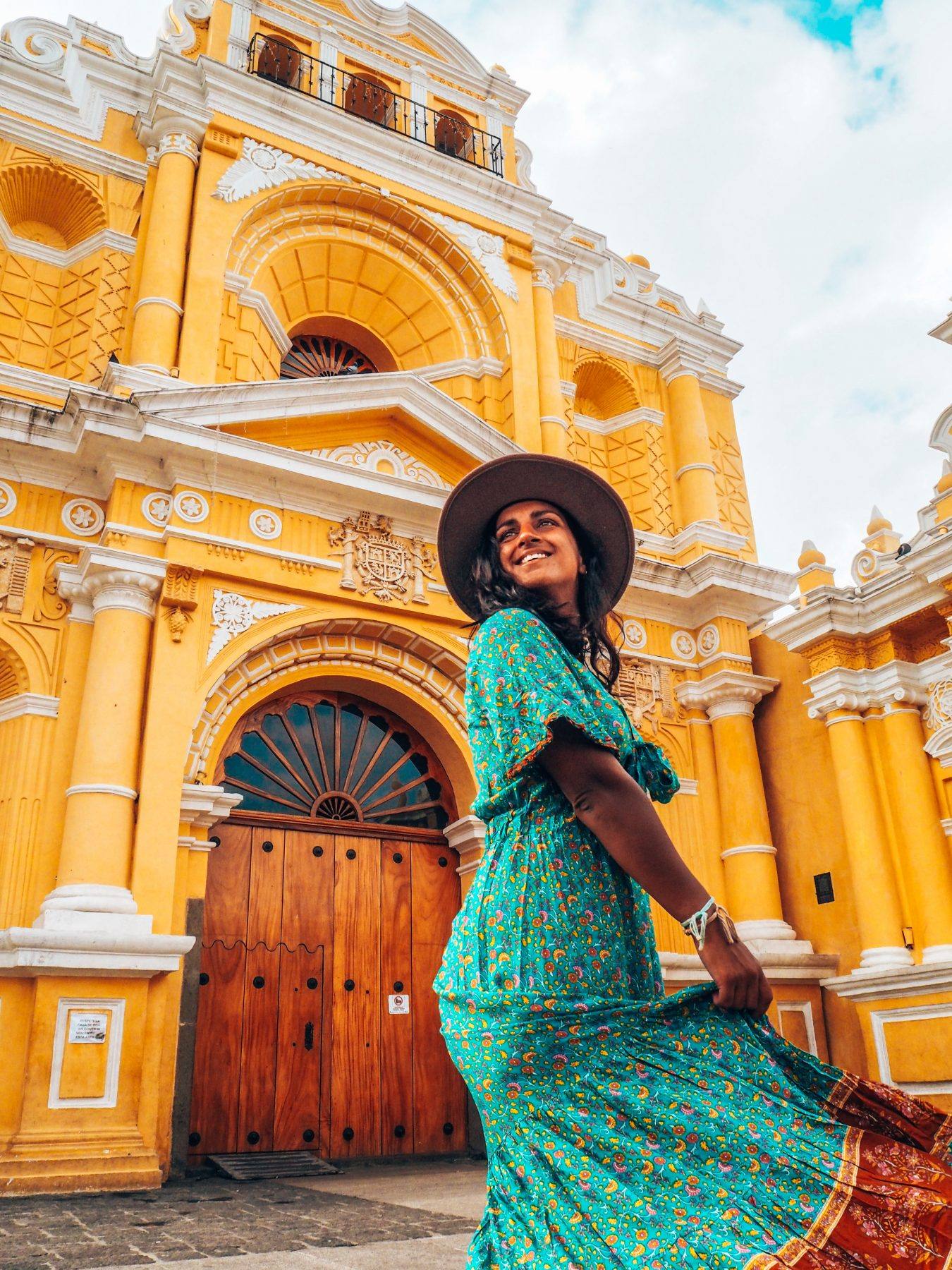 Antigua, Absolutely Lucy outside yellow church