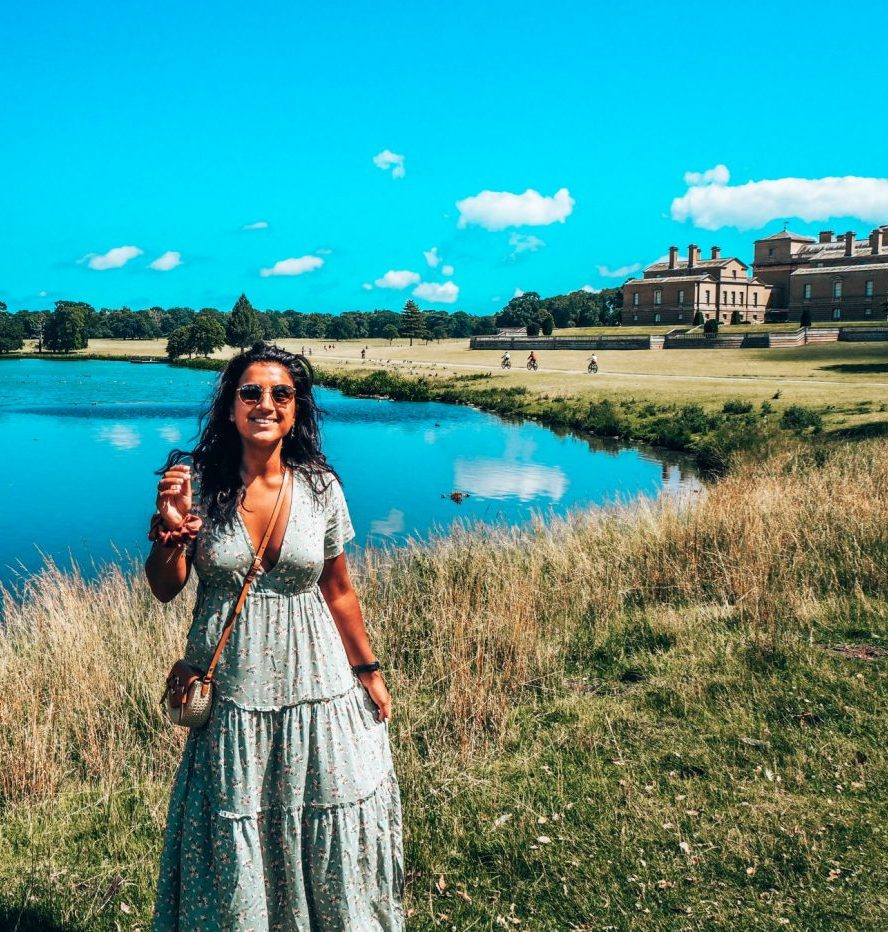 Norfolk stately homes visit – girl in front of lake wearing green dress, Holkham Hall, North Norfolk