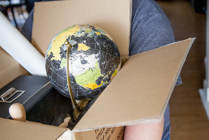 moving house, self storage, personal storage, cardboard box with globe