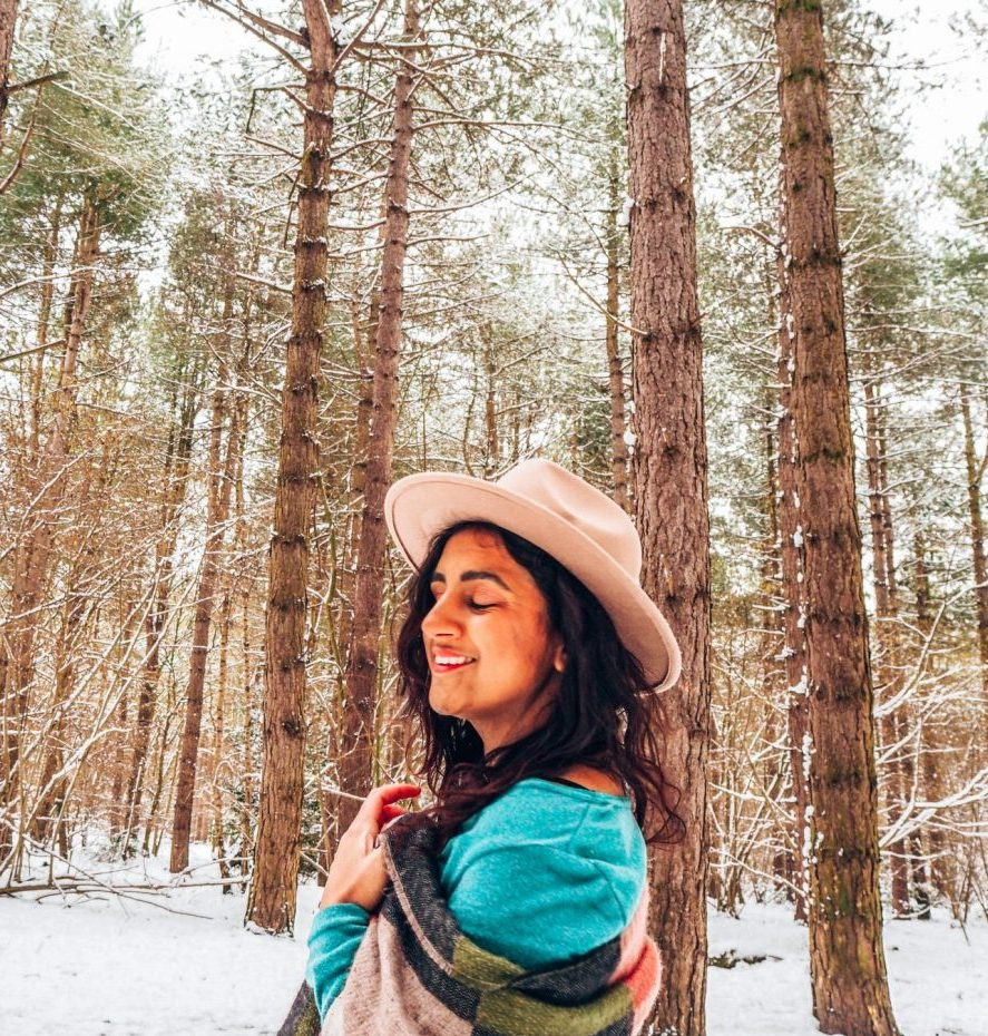 girl profile in brown hat with green dress and patterned scarf, Forest bathing in Norfolk, snow, outdoor lockdown activities